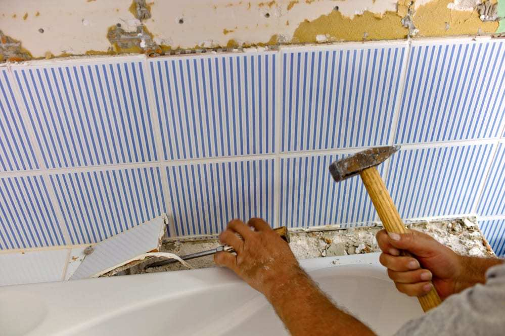 the renovation and refurbishment of a bathroom by a construction worker