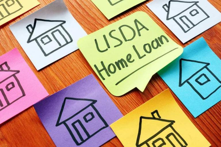 "Colorful post-it notes on desk, drawings of homes, one reads ""USDA Home Loans"""
