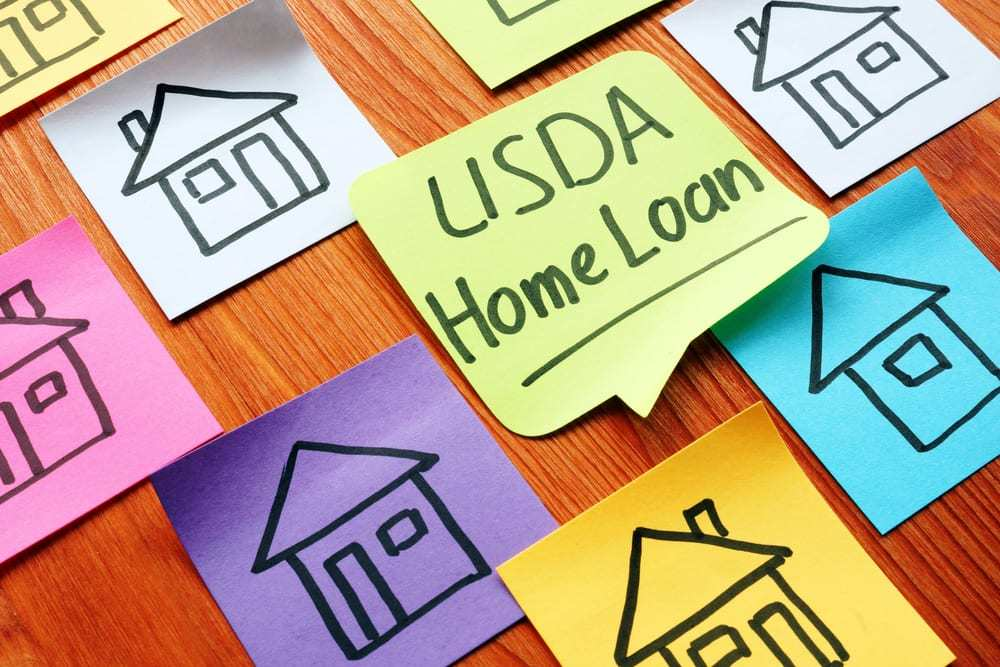 """Colorful post-it notes on desk, drawings of homes, one reads """"USDA Home Loans"""""""